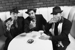 three guys having a party drinking cocktails and smoking