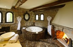 Chateau Eza Jacuzzi bath with fireplace